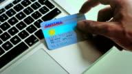 Online retail using a bank card & laptop  BU video