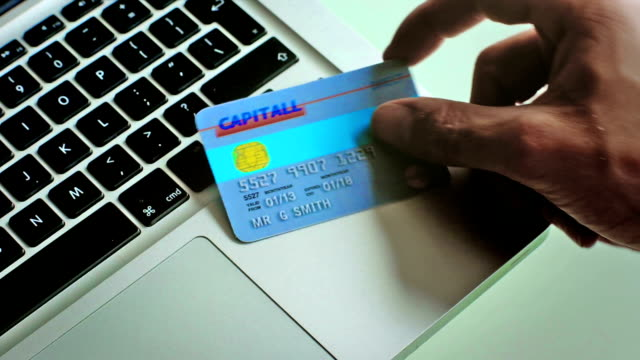 Online retail using a bank card & laptop  BU video