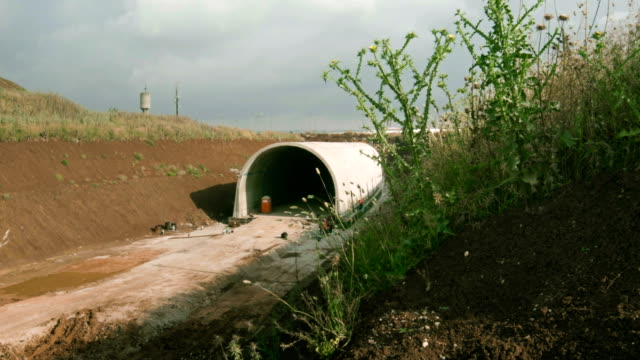 Сonstruction crew working in the ditch prepared for underground tunnel video