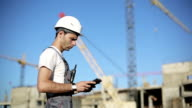 Сonstruction engineer with the tablet pictures of objects video