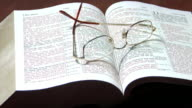 Open Bible with glasses video