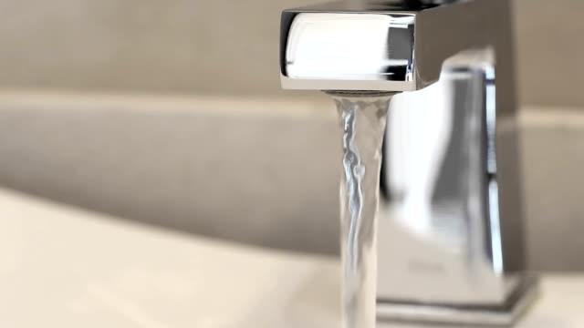 Open faucet in bathroom video