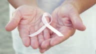 Open Hands Holding Breast Cancer Awareness Ribbon video