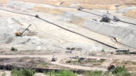 open pit coal mine with machinery video