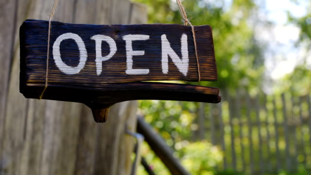 Open wood sign video