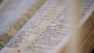 Opened Bible lies on the desk prepared for ceremony video