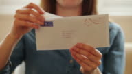 Opening a letter          LI CM RO video