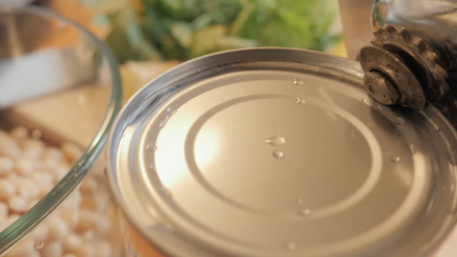 Opening a Tin Can with a Can Opener video