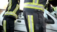 Opening carroof with firefighters. Saving victim carcrash video