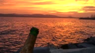 Opening champagne bottle against romantic sunset video