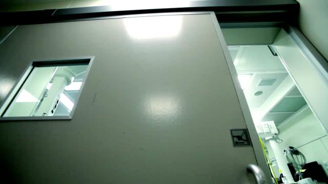 opening door operatin room in hospital video