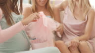Opening gifts on baby shower party video