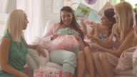 Opening presents on baby shower party video