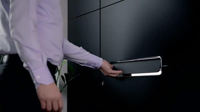 Opening the door of an apartment video