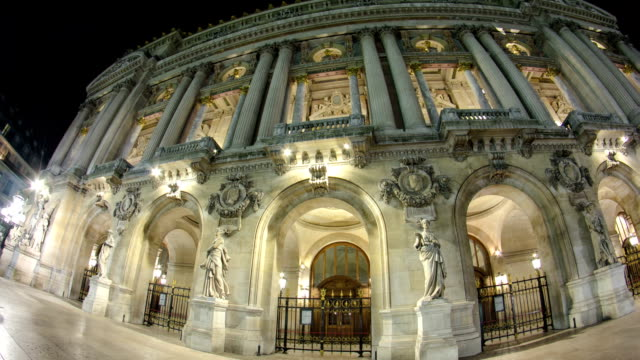 Opera National de Paris in the nighttime. Grand Opera Paris, France timelapse hyperlapse video
