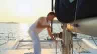 HD: Operating Sail Winch While Sailing At Sunset video