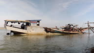 Operation of pumping sand out of a dredging boat through a pipe hold between bamboo canes video
