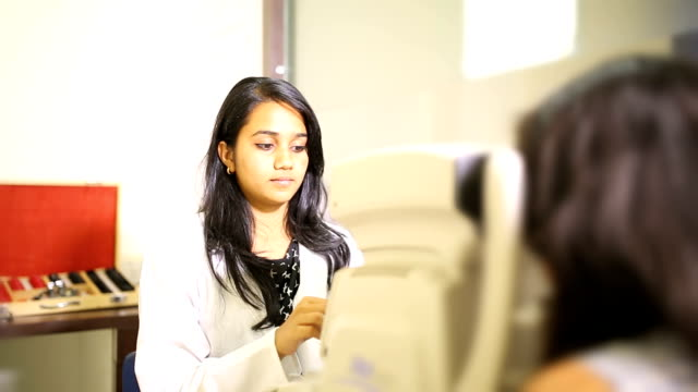 Ophthalmologist Examining a Patient in a Clinic video
