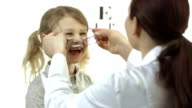 HD: Ophthalmologist Putting Glasses On Little Girl video