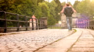 Optical flares effect video: a man walks along the old historic dam video