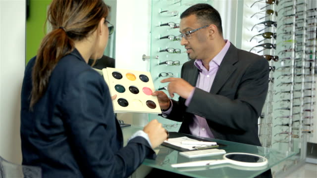 Optician demonstrating tinted lenses video