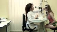 Optometrist examines the patient video