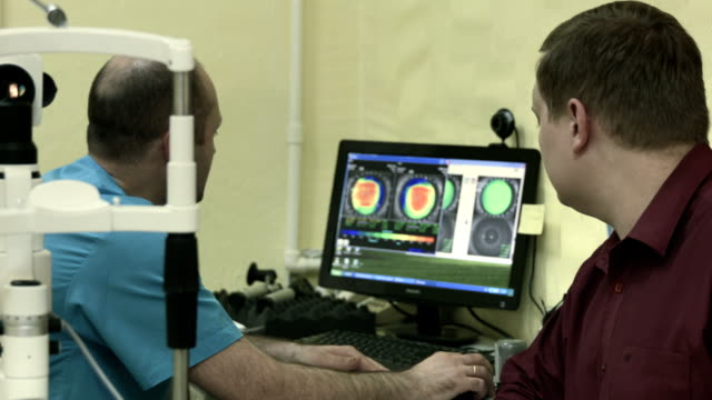 Optometrist explains something to patient after examination video