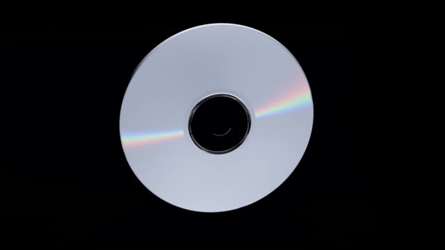 DVD or CD flying into player including loop and alpha/matte video