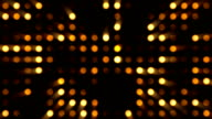 Orange Circles Music Video Background - Grid of Dots with Random Generative Effect on Black Background video