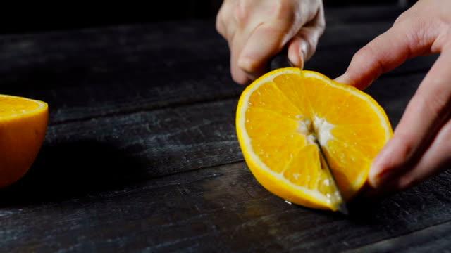 Orange Fruit Being cut and It's Splatters Juice video