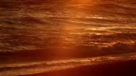 Orange Glow of Sunset over Pacific Ocean Waves: Malibu, California video