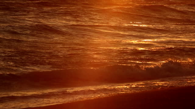 Orange Glow of Sunset over Pacific Ocean Waves: Malibu, California video