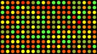Orange Green Red Yellow Multicoloured Circles Music Video Background - Grid of Dots with Random Generative Effect on Black Background video