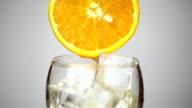 orange juice poured into a glass video