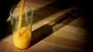 Orange Juice Poured Into Glass With Shadow video