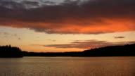 Orange lake sunset. Real time shot. video