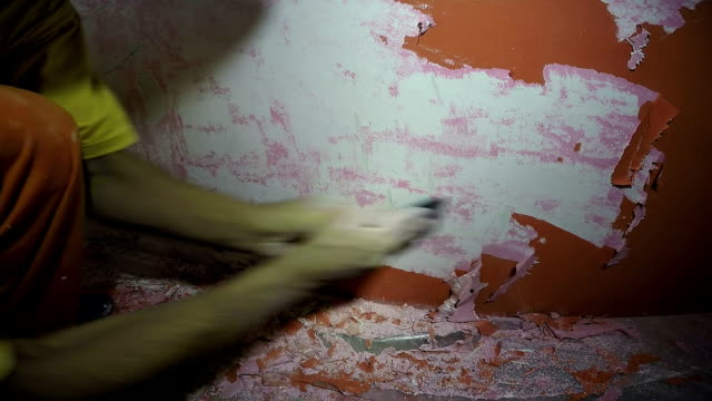 Orange Paint Chips Scraped off Wall video
