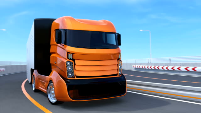 Orange self driving truck on the highway video