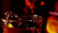 Orange slice falls into a beautiful mug of mulled wine video