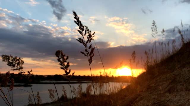 orange sunset on a quiet lake video