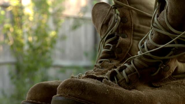 Orbit around desert combat boots video