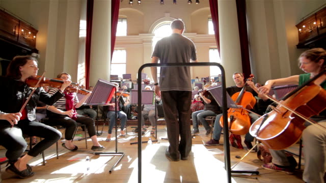 Orchestra with conductor wide angle video