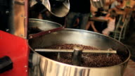 Organic Coffee Beans are Stirred in the Cooling Bin video