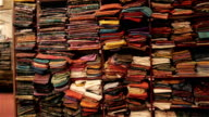 oriental clothing/material on the shop shelves video