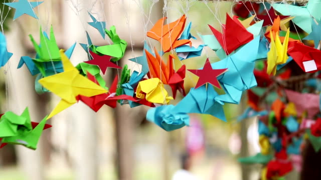 Origami paper bird spinning in wind, handmade, Japanese art of paper. video