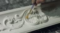 Ornament on gypsum cornice. video