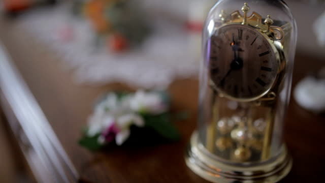 Ornate clock on table during wedding reception. video