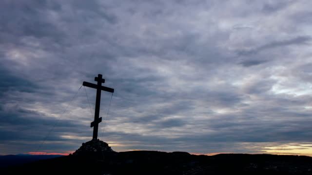 Orthodox Cross at the Top of the Hill with Moving Clouds on Background Timelapse video