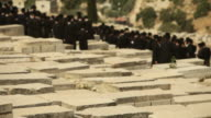 Orthodox Jews Praying in a Jerusalem Cemetery video