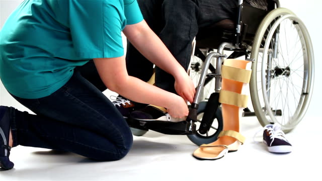 Orthopedic equipment for young man in wheelchair video